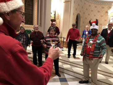 Jim Gardner, John Thomason, Denver Marlow, Tom Neil, Gary Mott, Chuck Marr, Harry Kindle, Keith Eyestone were among the Little Apple Chorus members who filmed two holiday favorites at Seven Dolors Catholic Church.